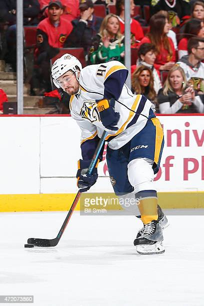 Taylor Beck of the Nashville Predators hits the puck in Game Six of the Western Conference Quarterfinals against the Chicago Blackhawks during the...
