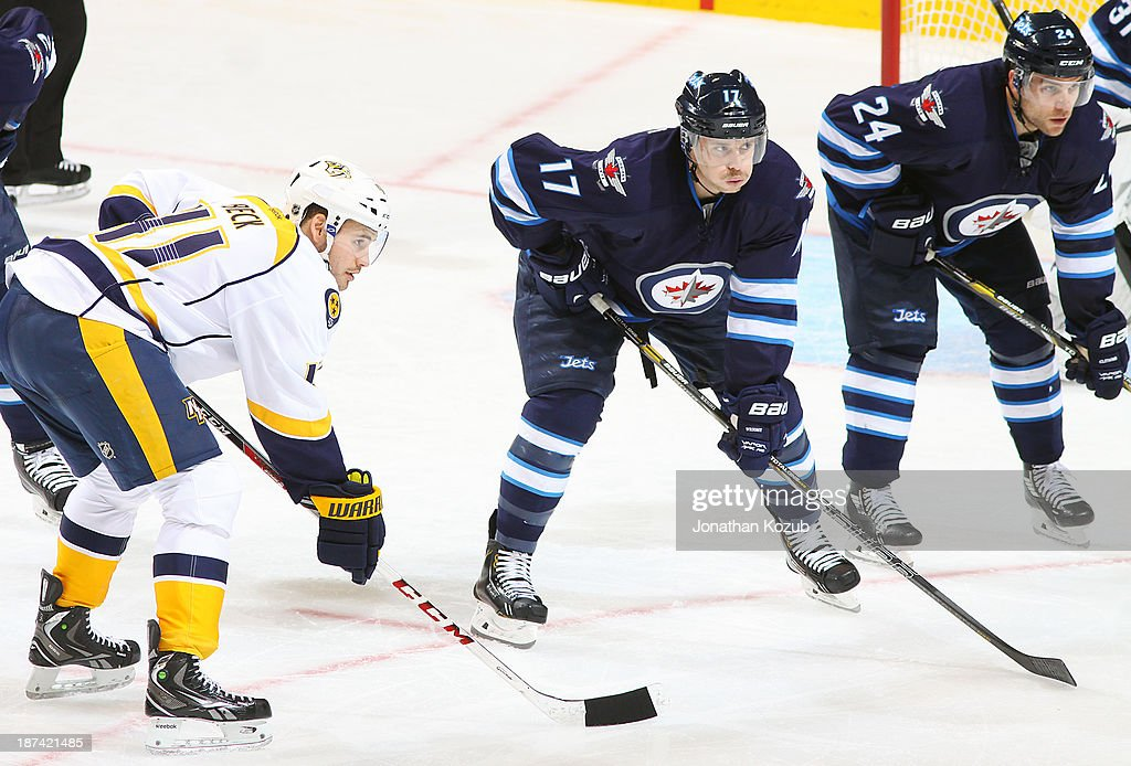 <a gi-track='captionPersonalityLinkClicked' href=/galleries/search?phrase=Taylor+Beck&family=editorial&specificpeople=4779404 ng-click='$event.stopPropagation()'>Taylor Beck</a> #41 of the Nashville Predators lines up against James Wright #17 and <a gi-track='captionPersonalityLinkClicked' href=/galleries/search?phrase=Grant+Clitsome&family=editorial&specificpeople=4596638 ng-click='$event.stopPropagation()'>Grant Clitsome</a> #24 of the Winnipeg Jets during a second period face-off at the MTS Centre on November 8, 2013 in Winnipeg, Manitoba, Canada.
