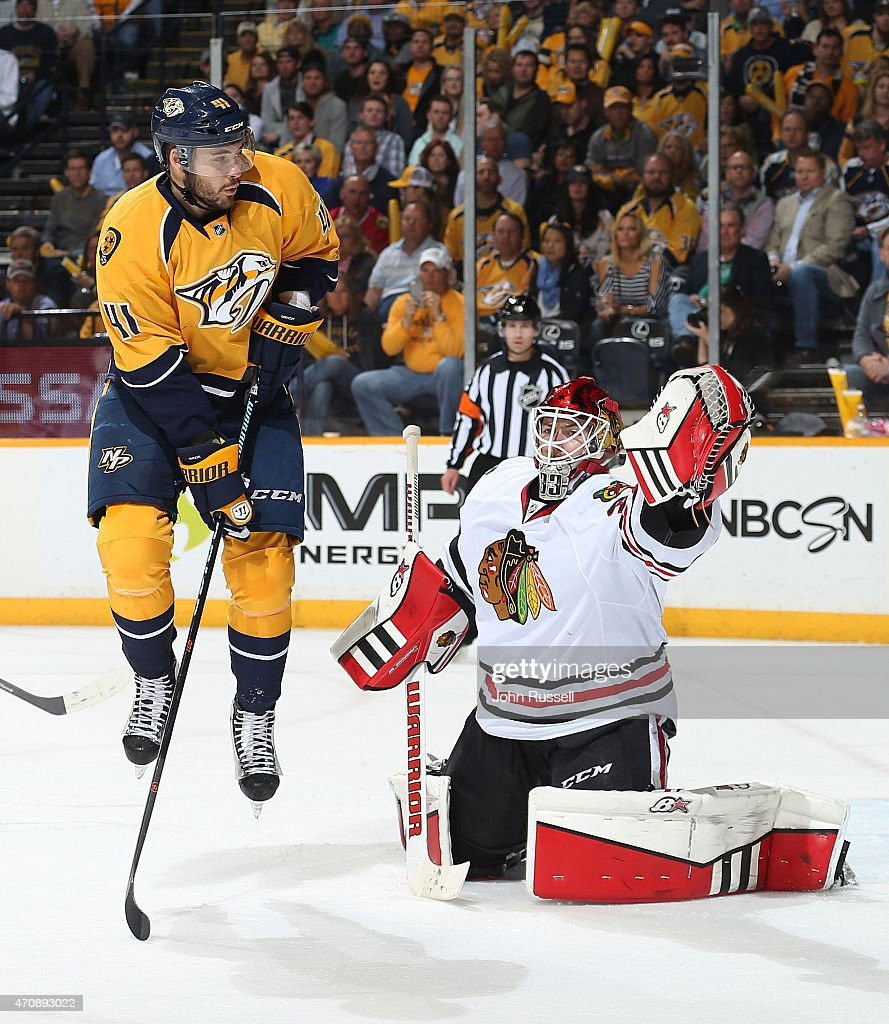 Taylor Beck #41 of the Nashville Predators screens Scott Darling #33 of the Chicago Blackhawks on a shot in Game Five of the Western Conference Quarterfinals during the 2015 NHL Stanley Cup Playoffs at Bridgestone Arena on April 23, 2015 in Nashville, Tennessee.