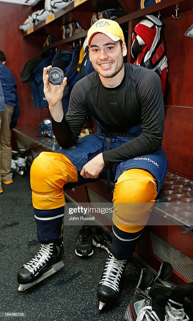 Taylor Beck #56 of the Nashville Predators shows off his first NHL goal puck against the Columbus Blue Jackets during an NHL game at the Bridgestone Arena on March 23, 2013 in Nashville, Tennessee.