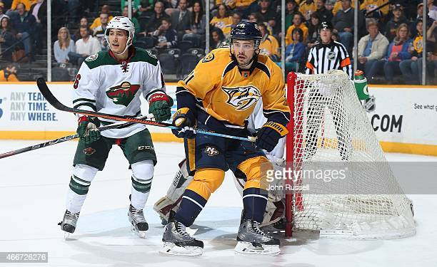 Taylor Beck of the Nashville Predators skates against Jared Spurgeon of the Minnesota Wild during an NHL game at Bridgestone Arena on March 17 2015...