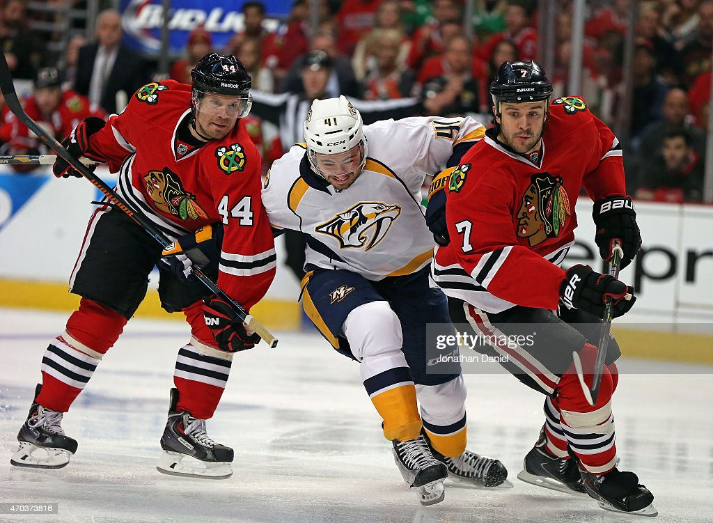 Taylor Beck #41 of the Nashville Predators tries to get between Kimmo Timonen #44 and Brent Seabrook #7 of the Chicago Blackhawks in Game Three of the Western Conference Quarterfinals during the 2015 NHL Stanley Cup Playoffs at the United Center on April 19, 2015 in Chicago, Illinois.