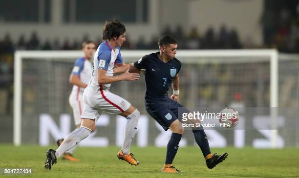 Taylor Booth of the United States challenges Philip Foden of England during the FIFA U17 World Cup India 2017 Quarter Final match between USA and...