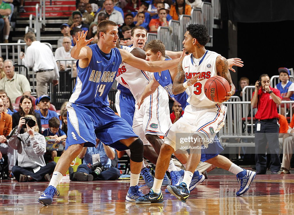 Taylor Broekhuis #34 of the Air Force Falcons defends against Mike Rosario #3 of the Florida Gators at the MetroPCS Orange Bowl Basketball Classic on December 29, 2012 at the BB&T Center in Sunrise, Florida. The Gators defeated the Falcons 78-61.