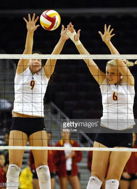 Taylor Carico and Katelyn Bishop of USC team up for a block during Pacific10 Conference Women's Volleyball match between Oregon and USC at the Galen...