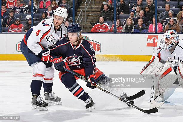 Taylor Chorney of the Washington Capitals and William Karlsson of the Columbus Blue Jackets battle for position on January 19 2016 at Nationwide...