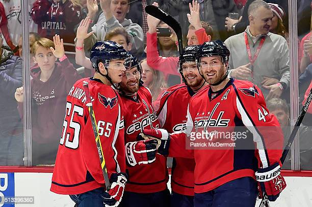 Taylor Chorney of the Washington Capitals celebrates his first period goal with his teammates during their game against the Toronto Maple Leafs at...