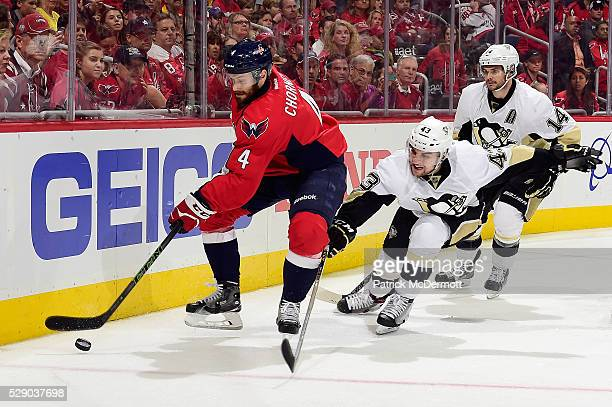 Taylor Chorney of the Washington Capitals controls the puck against Conor Sheary of the Pittsburgh Penguins in the third period in Game Five of the...