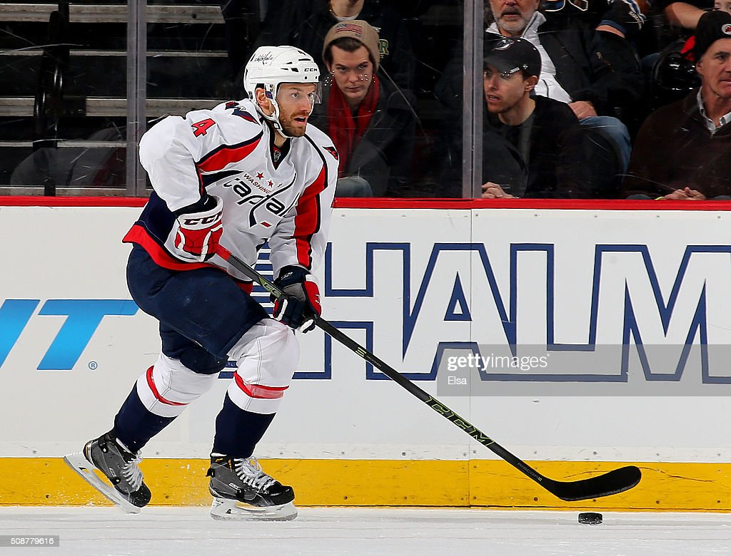 <a gi-track='captionPersonalityLinkClicked' href=/galleries/search?phrase=Taylor+Chorney&family=editorial&specificpeople=700392 ng-click='$event.stopPropagation()'>Taylor Chorney</a> #4 of the Washington Capitals takes the puck in the third period against the New Jersey Devils on February 6, 2016 at Prudential Center in Newark, New Jersey.The Washington Capitals defeated the New Jersey Devils 3-2 in an overtime shootout.