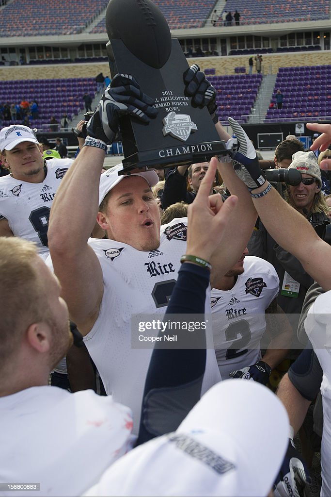 Taylor Cook #3 of the Rice Owls hoists the trophy after defeating the Air Force Falcons in the Bell Helicopter Armed Forces Bowl on December 29, 2012 at Amon G. Carter Stadium in Fort Worth, Texas.
