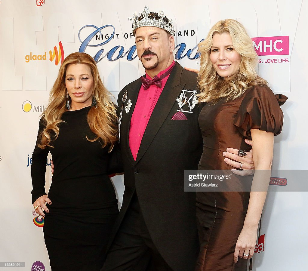 <a gi-track='captionPersonalityLinkClicked' href=/galleries/search?phrase=Taylor+Dayne&family=editorial&specificpeople=213650 ng-click='$event.stopPropagation()'>Taylor Dayne</a> , Gary Cosgrove and Aviva Drescher attend the 27th Annual Night Of A Thousand Gowns at the Hilton New York on April 6, 2013 in New York City.