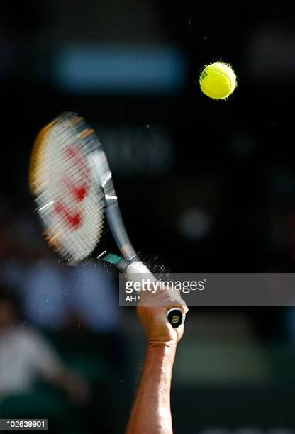 Taylor Dent of the US serves the ball to Serbia's Novak Djokovic on the third day of the Wimbledon Tennis Championships at the All England Tennis...