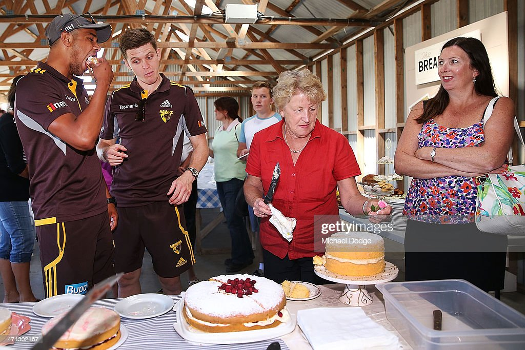 Taylor Duryea and Dayle Garlett (L) test out the cakes in the cake baking competition at the Bream Creek Oval during the Hawthorn Hawks AFL Tasmania Community Camp on February 23, 2014 in Bream Creek, Australia.