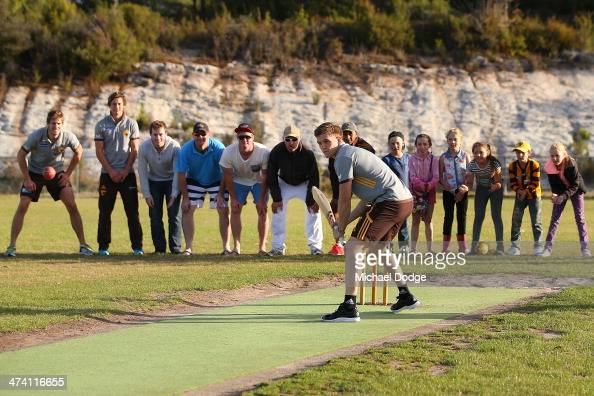 Taylor Duryea gets ready to hit the ball in a game of cricket with members of the Port Arthur Cricket Club during the Hawthorn Hawks AFL Community...