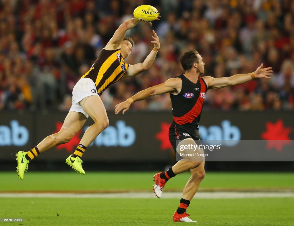 Taylor Duryea of the Hawks (L) and Travis Colyer of the Bombers compete for the ball during the round one AFL match between the Essendon Bombers and the Hawthorn Hawks at Melbourne Cricket Ground on March 25, 2017 in Melbourne, Australia.