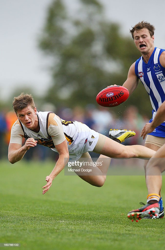 Taylor Duryea of the Hawks handpasses the ball during the AFL NAB Cup match between the North Melbourne Kangaroos and the Hawthorn Hawks at Highgate Recreational Reserve on March 16, 2013 in Craigieburn, Australia.