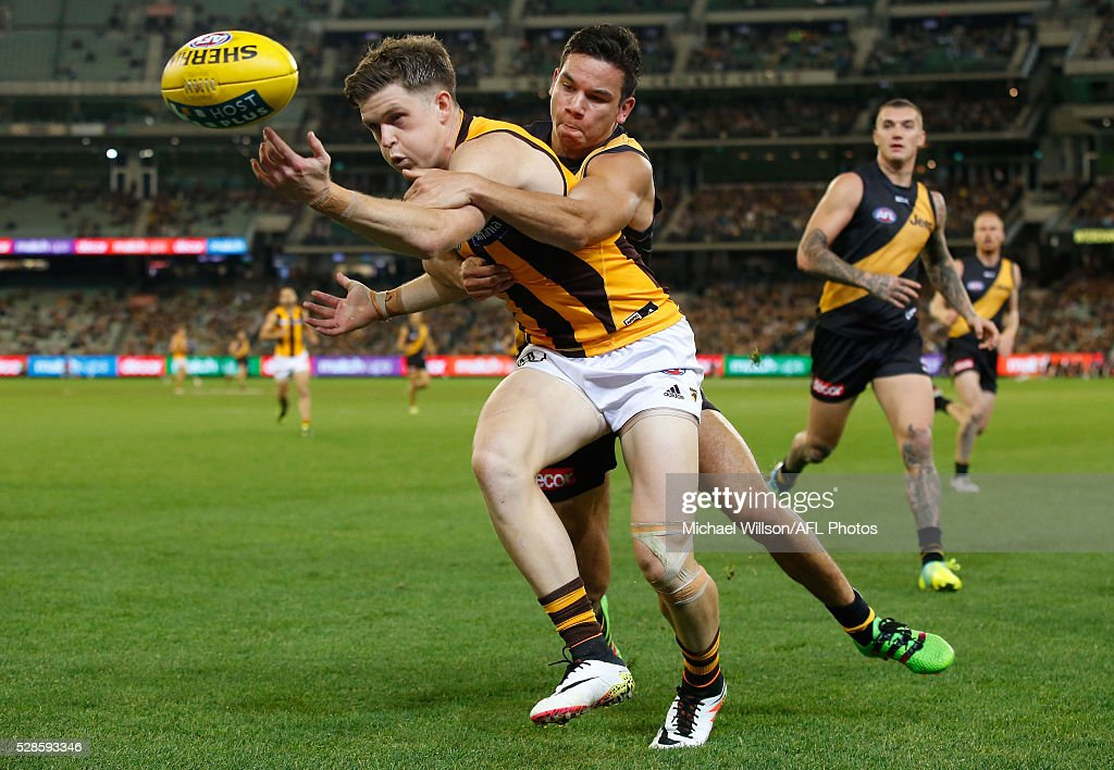 Taylor Duryea of the Hawks is tackled by Daniel Rioli of the Tigers during the 2016 AFL Round 07 match between the Richmond Tigers and the Hawthorn Hawks at the Melbourne Cricket Ground, Melbourne on May 6, 2016.