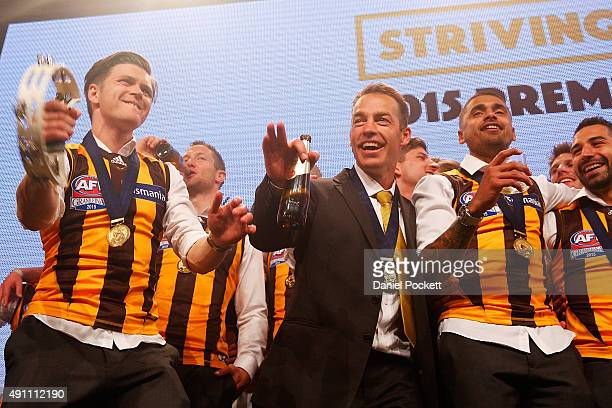 Taylor Duryea plays Tambourine while the Hawthorn Hawks join Daryl Braithwaite on stage for a performance of Horses during the Hawthorn Hawks AFL...
