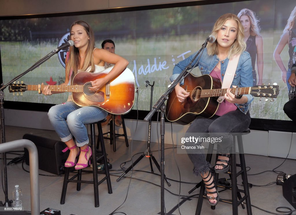 Taylor Dye (L) and Madison Marlow of Maddie & Tae perform at Macy's at Macy's Herald Square on August 19, 2017 in New York City.