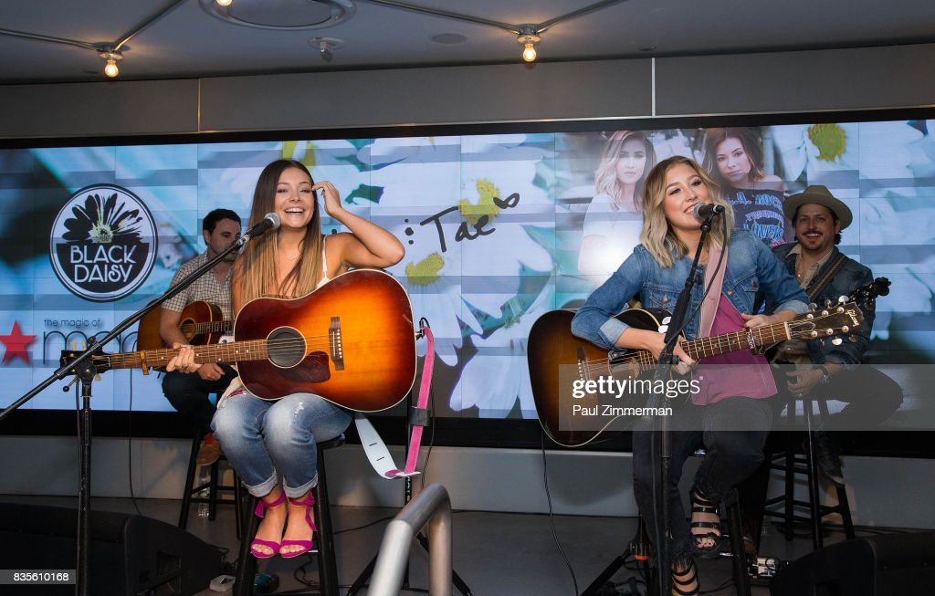 Taylor Dye (L) and Madison Marlow of Maddie & Tae perform at Macy's Herald Square on August 19, 2017 in New York City.