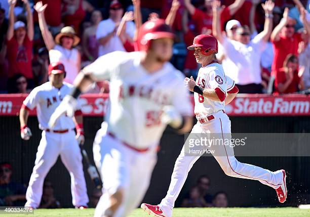 Taylor Featherston of the Los Angeles Angels scores a run from a Kole Calhoun single to take a 32 lead over the Seattle Mariners during the eighth...