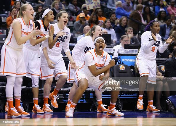 Taylor Ford of the Syracuse Orange and teammates react on the bench in the fourth quarter against the Washington Huskies during the semifinals of the...