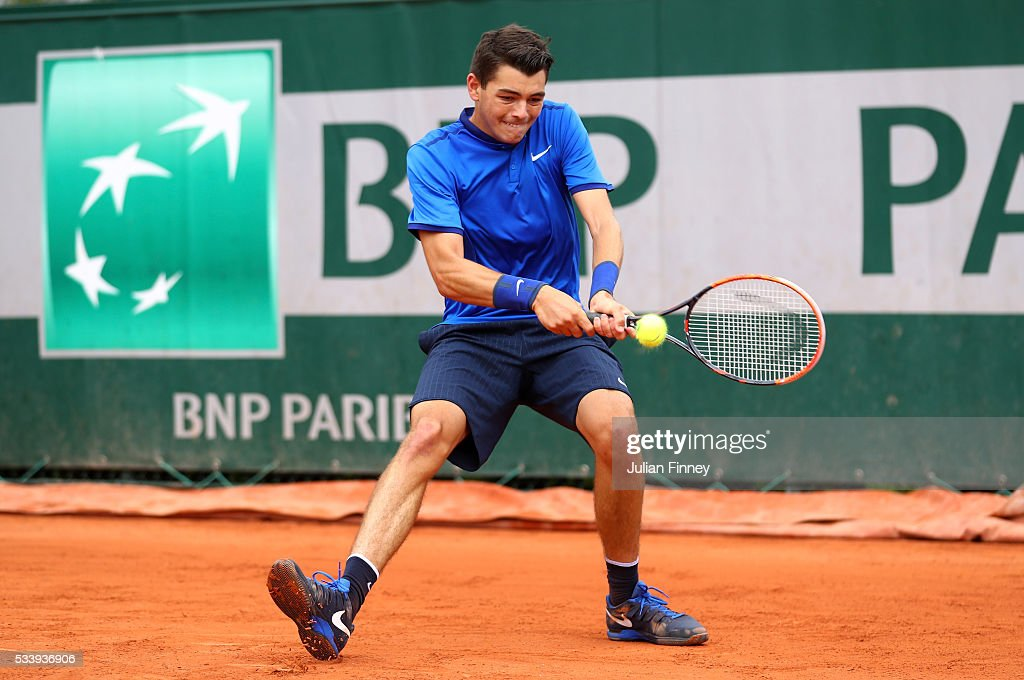 Taylor Fritz of the United States plays a backhand during the Men's Singles first round match against Borna Coric of Croatia on day three of the 2016 French Open at Roland Garros on May 24, 2016 in Paris, France.