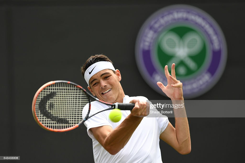 <a gi-track='captionPersonalityLinkClicked' href=/galleries/search?phrase=Taylor+Fritz&family=editorial&specificpeople=14747640 ng-click='$event.stopPropagation()'>Taylor Fritz</a> of The United States plays a backhand during the Men's Singles first round match against Stan Wawrinka of Switzerland on day two of the Wimbledon Lawn Tennis Championships at the All England Lawn Tennis and Croquet Club on June 28, 2016 in London, England.