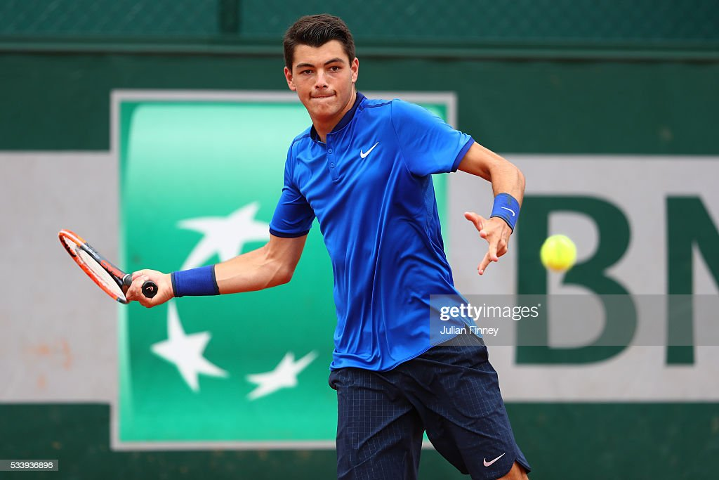 Taylor Fritz of the United States plays a forehand during the Men's Singles first round match against Borna Coric of Croatia on day three of the 2016 French Open at Roland Garros on May 24, 2016 in Paris, France.