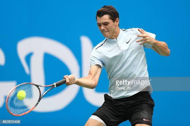 Taylor Fritz of the United States returns a shot during the match against Marco Chiudinelli of Switzerland during Qualifying second round of 2017 ATP...