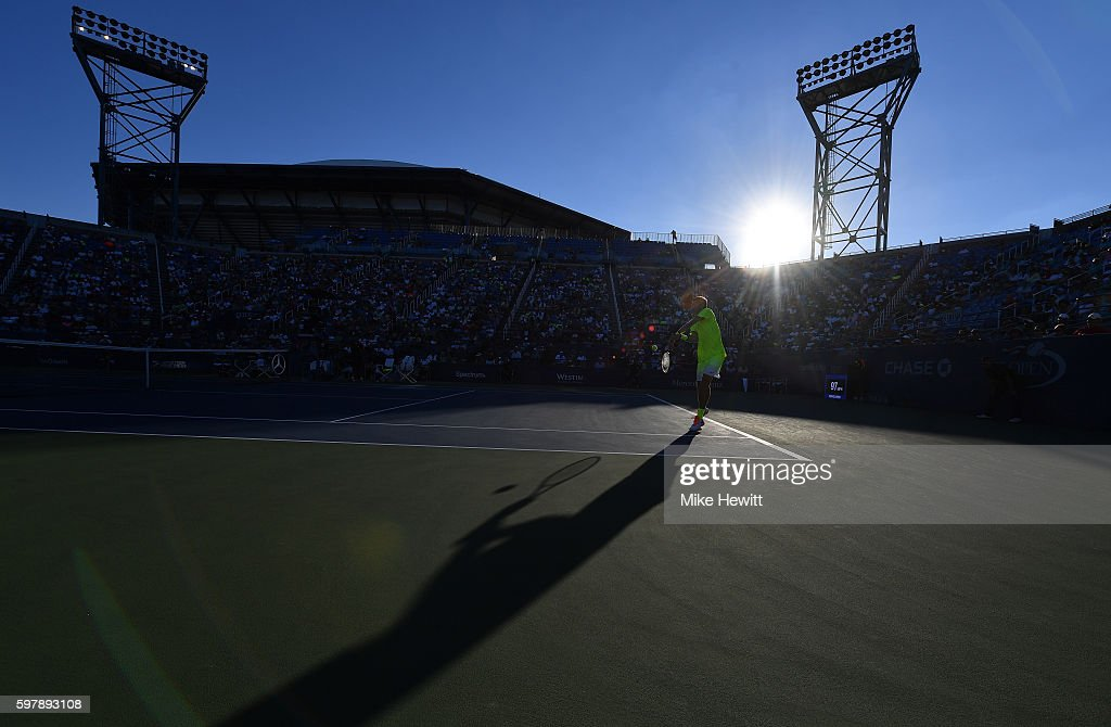 Taylor Fritz of the United States returns a shot to Jack Sock of the United States during his first round Men's Singles match on Day One of the 2016...