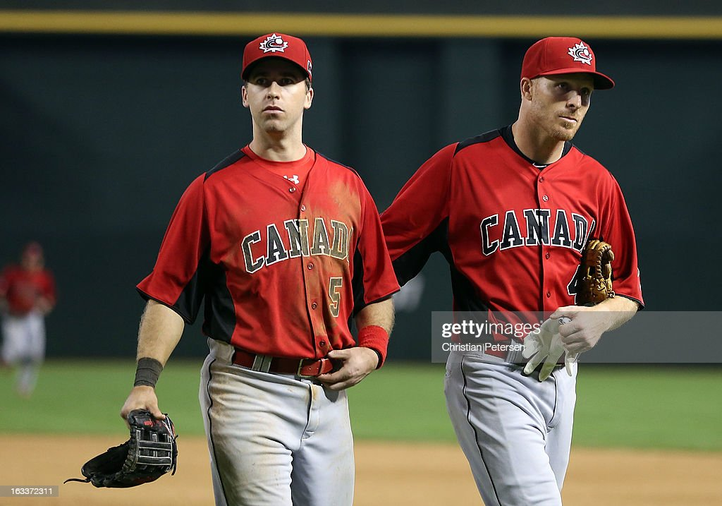 Taylor Green #5 and Pete Orr #4 of Canada walk off the field after being defeated by Italy in the World Baseball Classic First Round Group D game at Chase Field on March 8, 2013 in Phoenix, Arizona. Italy defeated Canada 14-4 by mercy rule in eight innings.
