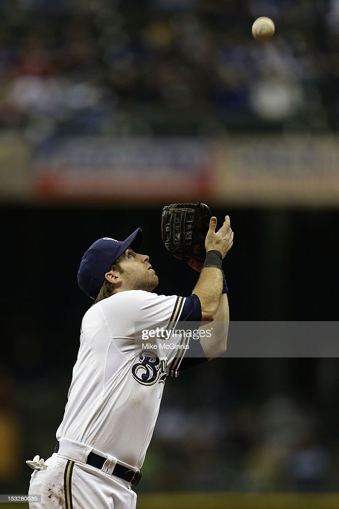 <a gi-track='captionPersonalityLinkClicked' href=/galleries/search?phrase=Taylor+Green&family=editorial&specificpeople=7222245 ng-click='$event.stopPropagation()'>Taylor Green</a> #5 of the Milwaukee Brewers makes the catch in the infield to retire Mark Kotsay #14 of the San Diego Padres during the top of the second inning at Miller Park on October 2, 2012 in Milwaukee, Wisconsin.