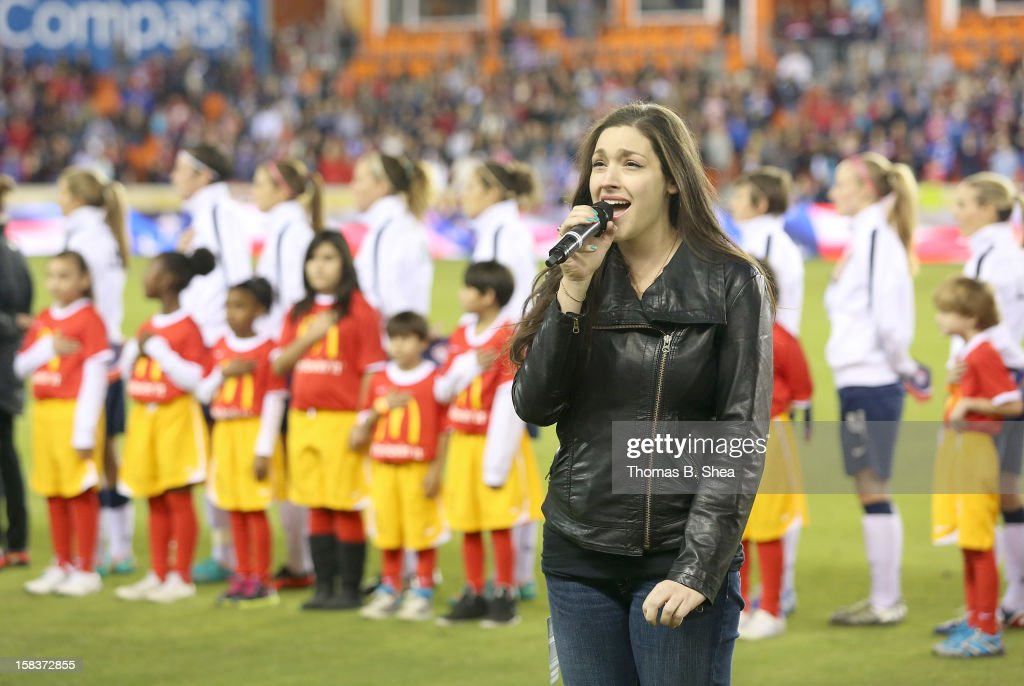 Taylor Greenwood sings the National Anthem before the U.S. Women's National Team played against the China Women's National Team in an international friendly game at BBVA Compass Stadium on December 12, 2012 in Houston, Texas. USA won 4 to 0.