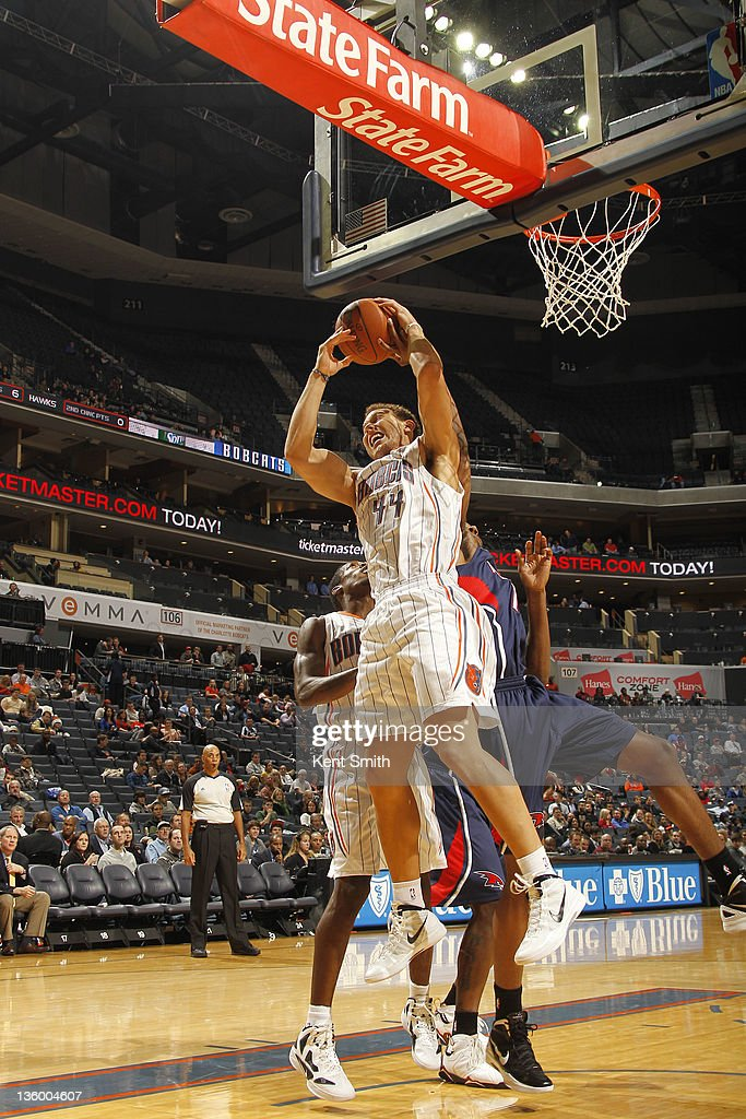 Taylor Griffin #44 of the Charlotte Bobcats gets a rebound against the Atlanta Hawks on December 19, 2011 during the preseason game at the Time Warner Cable Arena in Charlotte, North Carolina.
