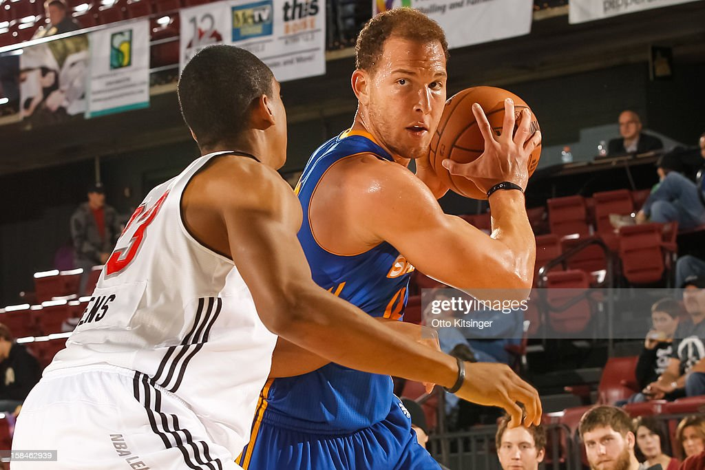<a gi-track='captionPersonalityLinkClicked' href=/galleries/search?phrase=Taylor+Griffin&family=editorial&specificpeople=4185737 ng-click='$event.stopPropagation()'>Taylor Griffin</a> #12 of the Santa Cruz Warriors defends the ball from <a gi-track='captionPersonalityLinkClicked' href=/galleries/search?phrase=Josh+Owens&family=editorial&specificpeople=4955635 ng-click='$event.stopPropagation()'>Josh Owens</a> #33 of the Idaho Stampede on December 15, 2012 at CenturyLink Arena in Boise, Idaho.