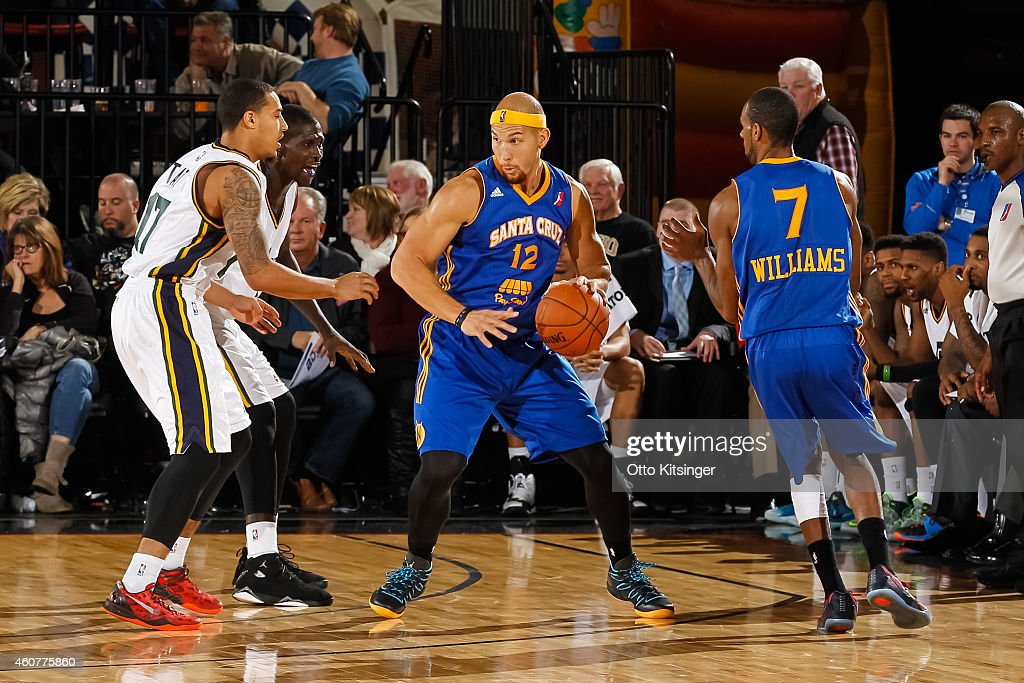 Taylor Griffin of the Santa Cruz Warriors dribbles the ball against Tyrrel Tate and Amadou Mbodji of the Idaho Stampede during an NBA DLeague game on...