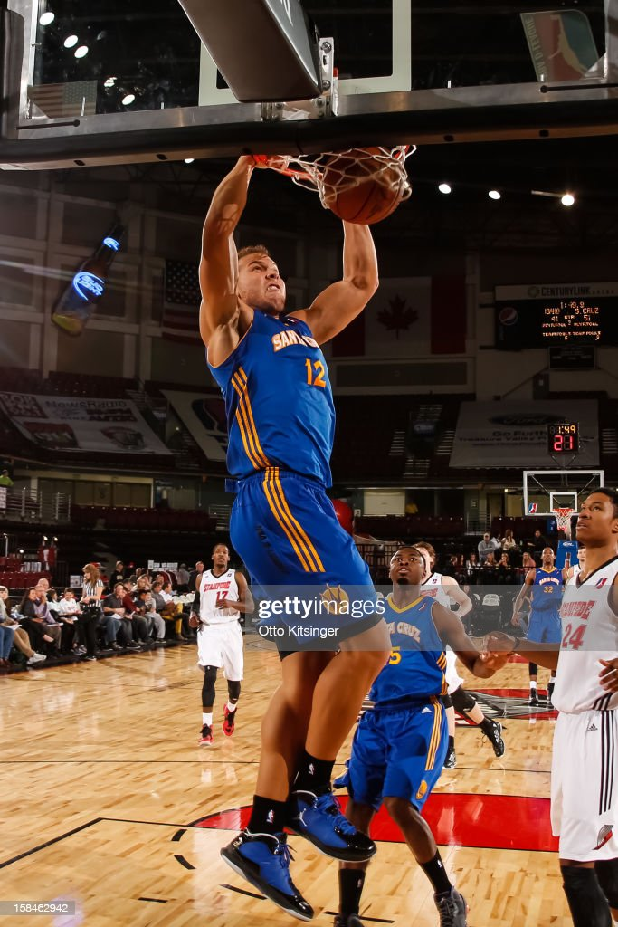 <a gi-track='captionPersonalityLinkClicked' href=/galleries/search?phrase=Taylor+Griffin&family=editorial&specificpeople=4185737 ng-click='$event.stopPropagation()'>Taylor Griffin</a> #12 of the Santa Cruz Warriors dunks against the Idaho Stampede on December 15, 2012 at CenturyLink Arena in Boise, Idaho.