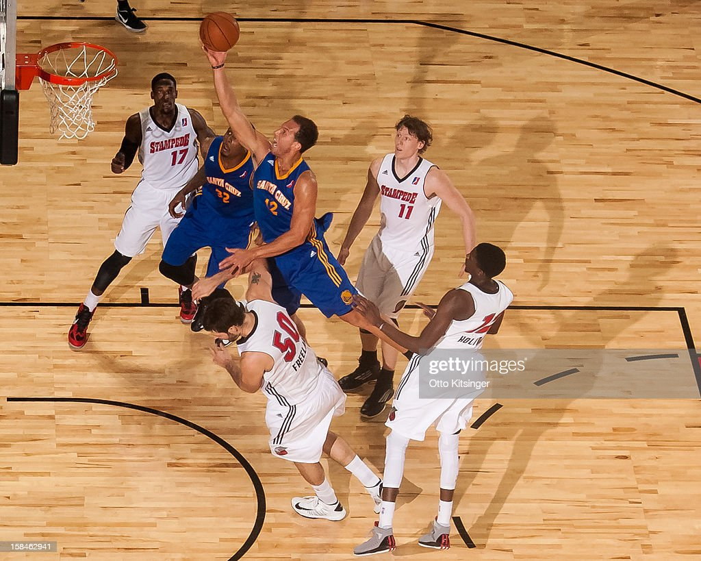<a gi-track='captionPersonalityLinkClicked' href=/galleries/search?phrase=Taylor+Griffin&family=editorial&specificpeople=4185737 ng-click='$event.stopPropagation()'>Taylor Griffin</a> #12 of the Santa Cruz Warriors goes up to the basket over <a gi-track='captionPersonalityLinkClicked' href=/galleries/search?phrase=Joel+Freeland&family=editorial&specificpeople=757235 ng-click='$event.stopPropagation()'>Joel Freeland</a> #10 of the Idaho Stampede on December 15, 2012 at CenturyLink Arena in Boise, Idaho. Freeland was on assignment from the Portland Trail Blazers.