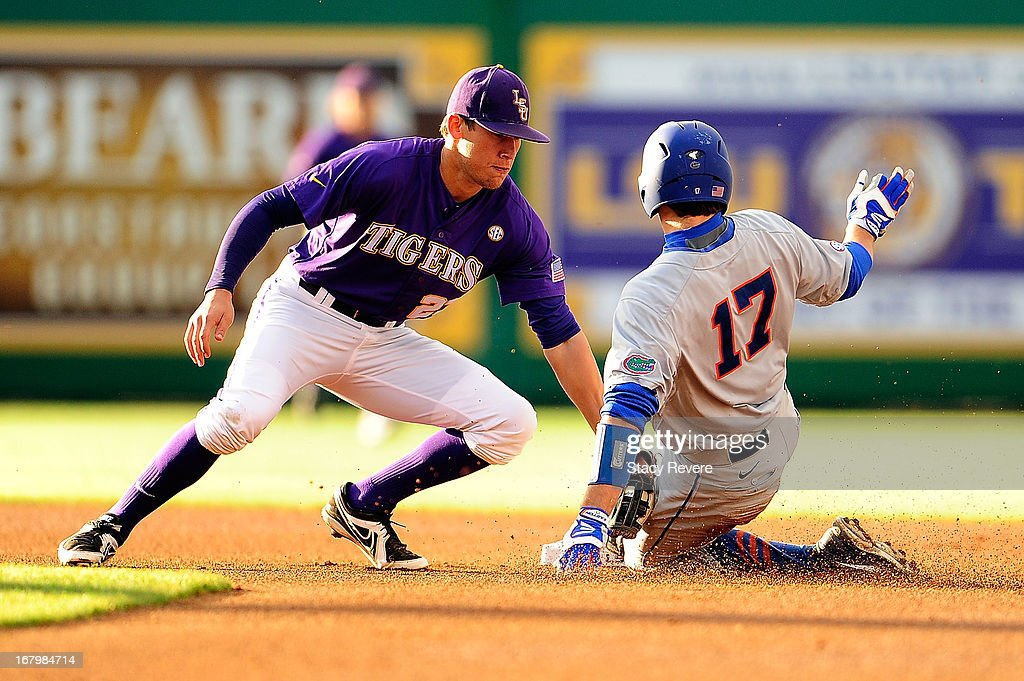 Taylor Gushue #17 of the Florida Gators is tagged out by <a gi-track='captionPersonalityLinkClicked' href=/galleries/search?phrase=Jacoby+Jones&family=editorial&specificpeople=4167942 ng-click='$event.stopPropagation()'>Jacoby Jones</a> #23 of the LSU Tigers during a game at Alex Box Stadium on May 3, 2013 in Baton Rouge, Louisiana.