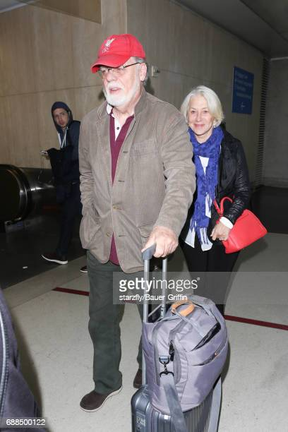 Taylor Hackford and Helen Mirren is seen at LAX on May 25 2017 in Los Angeles California