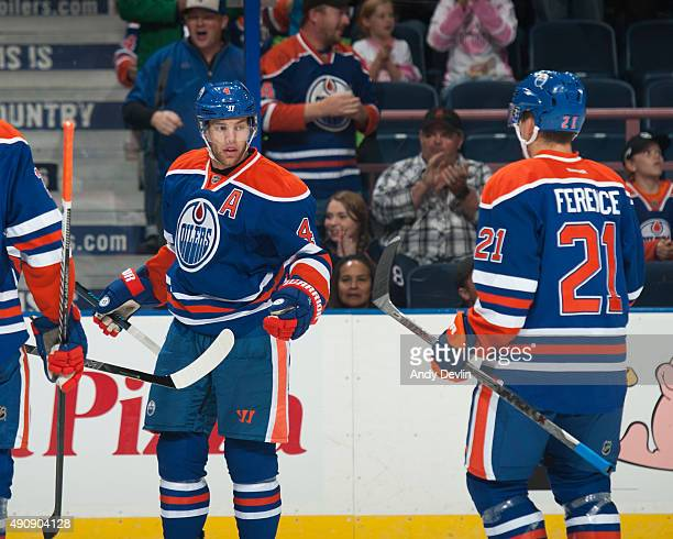 Taylor Hall and Andrew Ference of the Edmonton Oilers celebrate after a goal during a preseason game against the Vancouver Canucks on October 1 2015...