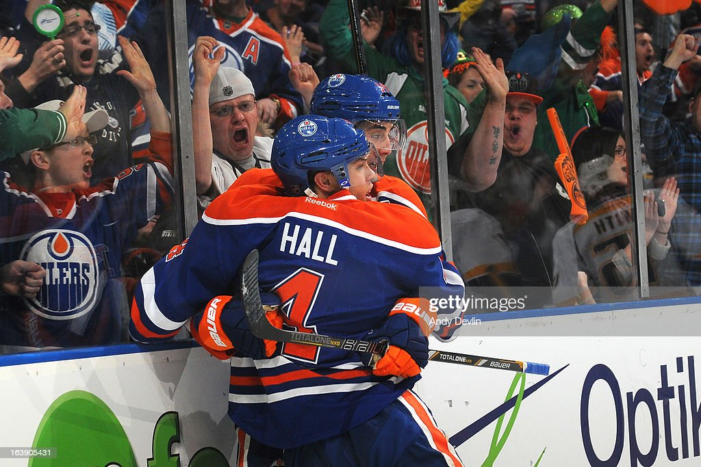 <a gi-track='captionPersonalityLinkClicked' href=/galleries/search?phrase=Taylor+Hall&family=editorial&specificpeople=2808377 ng-click='$event.stopPropagation()'>Taylor Hall</a> #4 and <a gi-track='captionPersonalityLinkClicked' href=/galleries/search?phrase=Jordan+Eberle&family=editorial&specificpeople=4898161 ng-click='$event.stopPropagation()'>Jordan Eberle</a> #14 of the Edmonton Oilers celebrate after scoring a goal against the Nashville Predators on March 17, 2013 at Rexall Place in Edmonton, Alberta, Canada.