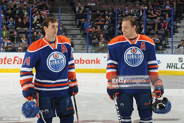 Taylor Hall and Jordan Eberle of the Edmonton Oilers exchange words prior to a game against the Vancouver Canucks on October 17 2014 at Rexall Place...
