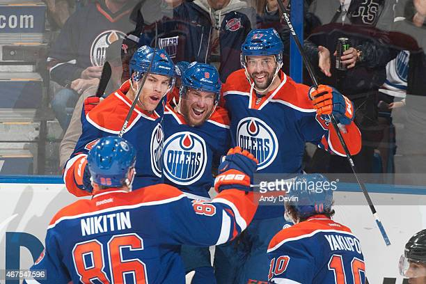 Taylor Hall Derek Roy and Benoit Pouliot of the Edmonton Oilers celebrate after a goal during the game against the Colorado Avalanche on March 25...