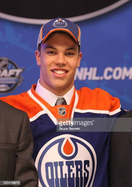 Taylor Hall drafted overall by the Edmonton Oilers poses on stage during the 2010 NHL Entry Draft at Staples Center on June 25 2010 in Los Angeles...