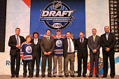 Taylor Hall drafted overall by the Edmonton Oilers poses with team personnel during the 2010 NHL Entry Draft at Staples Center on June 25 2010 in Los...