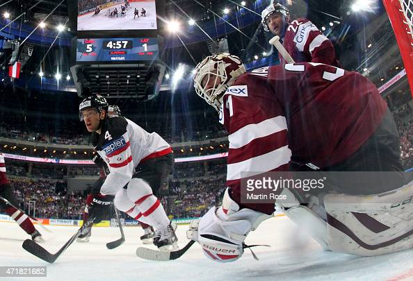 Taylor Hall of Canada fails to score over Edgars Masalskis goaltender of Latvia battle for the puck during the IIHF World Championship group A match...