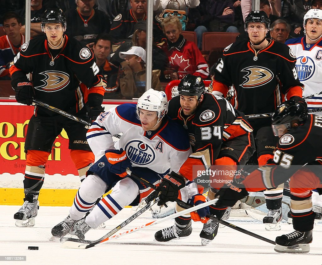 <a gi-track='captionPersonalityLinkClicked' href=/galleries/search?phrase=Taylor+Hall&family=editorial&specificpeople=2808377 ng-click='$event.stopPropagation()'>Taylor Hall</a> #4 of the Edmonton Oilers battles for the puck against <a gi-track='captionPersonalityLinkClicked' href=/galleries/search?phrase=Daniel+Winnik&family=editorial&specificpeople=2529214 ng-click='$event.stopPropagation()'>Daniel Winnik</a> #34 of the Anaheim Ducks on April 8, 2013 at Honda Center in Anaheim, California.