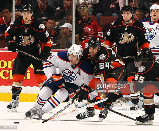 Taylor Hall of the Edmonton Oilers battles for the puck against Daniel Winnik of the Anaheim Ducks on April 8 2013 at Honda Center in Anaheim...